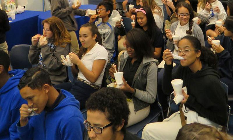 Andersen Middle School students tasting grits in a talk on African American Foods led by Tanya McMillan