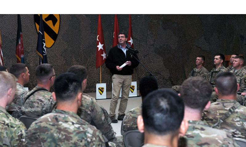 Secretary of Defense Ashton Carter speaks to airmen and soldiers during a visit to Kandahar Airfield, Afghanistan Feb. 22, 2015. Having sworn in only five days prior, the trip was Carter's first official visit to Afghanistan as defense secretary. (Whitney Amstutz/U.S. Air Force)