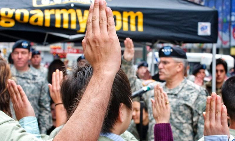 A group of recruits take the oath of enlistment in New York City in April 2009. (D. Myles Cullen/US Army)