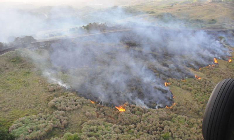 SANTA RITA, Guam (March 4, 2015) – Fire can be seen spreading through U.S. Naval Base Guam's (NBG) Munitions Annex in Santa Rita, March 4. Sailors from Helicopter Sea Combat Squadron 25 and firefighters from NBG's Fire and Emergency Services partnered to extinguish the blaze that affected approximately 20 acres of land. (Photo courtesy of Helicopter Sea Combat Squadron 25)