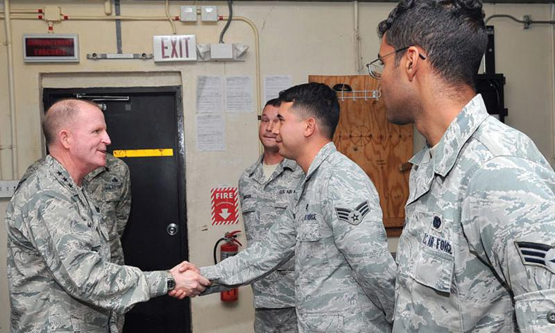 Lt. Gen. Stephen Wilson, commander of Air Force Global Strike Command, recognizes 36th Expeditionary Aircraft Maintenance Squadron Continuous Bomber Presence consolidated tool kit Airmen for their problem-solving initiatives March 3, 2015, at Andersen Air Force Base, Guam. (U.S. Air Force photo by Staff Sgt. Melissa B. White/Released)