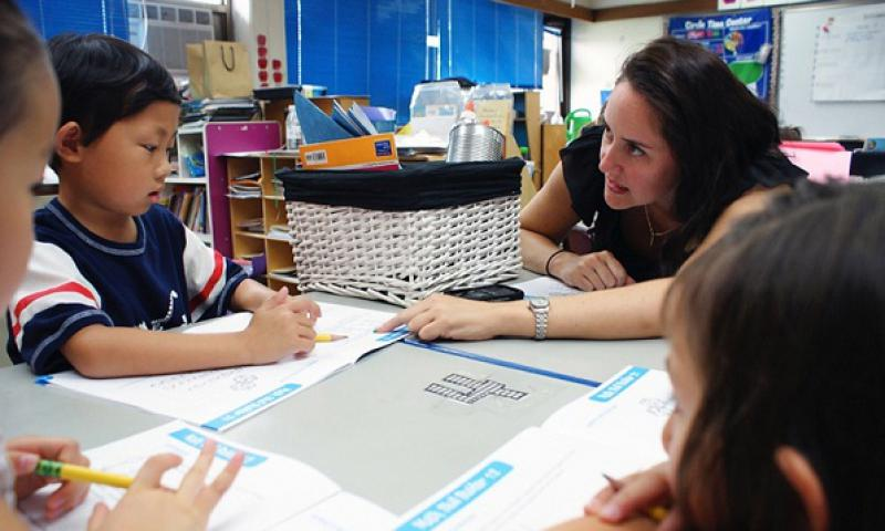 Calvin Yang listens as Cameron Gonzales teaches during a summer enrichment program held by Seoul American elementary and middle schools in Seoul, July 1, 2010. The Department of Defense Education Activity has decided to end the program due to declining participation and attendance. (Stars and Stripes)