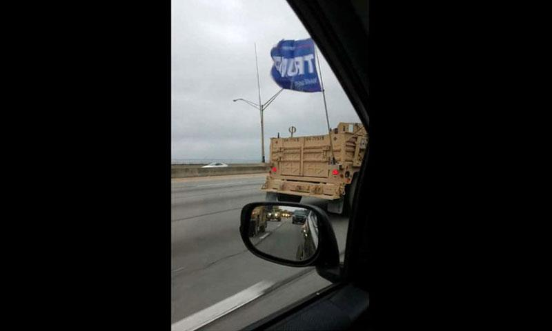 An apparent military convoy in Louisville, Ky., was seen flying a Trump campaign flag, which would be a violation of Defense Department regulations around political activity. (SCREENSHOT FROM VIDEO BY STEVE THOMPSON)