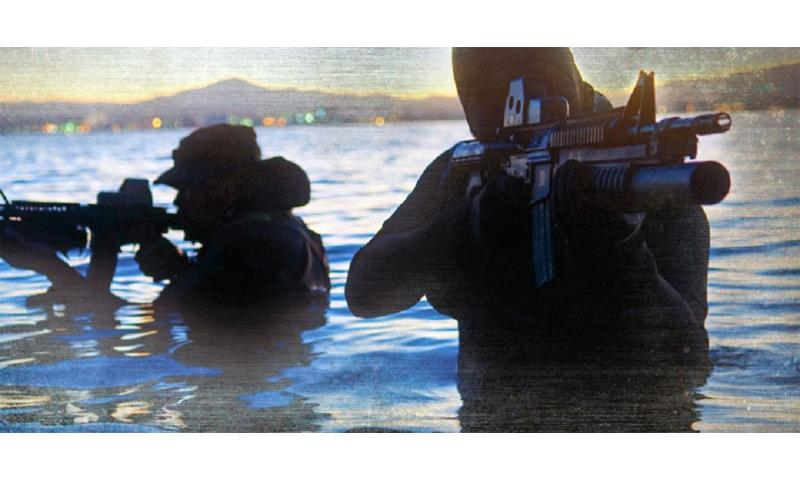 Navy SEALs are shown training in this undated photo. The first female Navy SEAL candidates could arrive at pre-training as early as mid-May, and the Marines will start sending women ground combat candidates to boot camp as soon as April. (U.S. Navy)