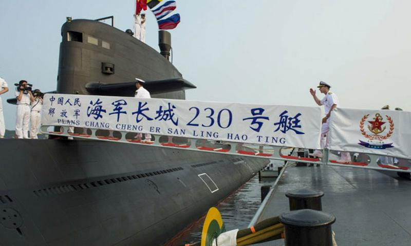 Chief of Naval Operations Adm. Jonathan Greenert boards a People's Liberation Army Navy Type-39B submarine July 17, 2014, for a tour on Lushun Naval Base in Dalian, China. (Peter D. Lawlor/U.S. Navy)