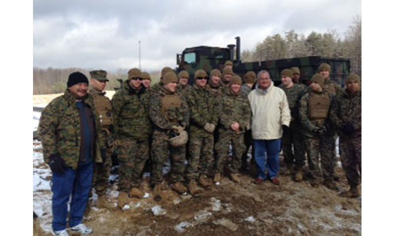 Speaker Joseph P. Deleon Guerrero (far left) and Congressman Kilili Camacho Sablan pause for a photo with Marines during a January tour of the range complex at Marine Corps Base Quantico, Va., where they observed live-fire artillery training.  (Official U.S. Marine Corps photo)