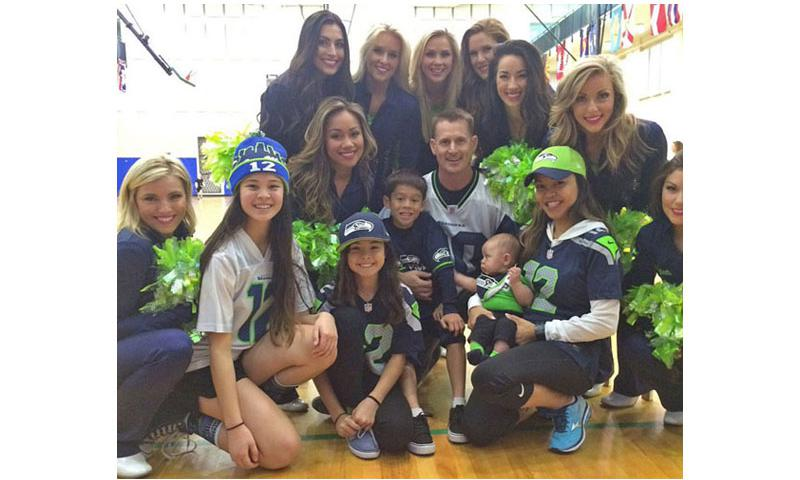 Seattle Seahawk cheerleaders pose with some fans following an Armed Forces Entertainment show at Naval Air Station Sigonella in Sicily. The Sea Gals had to cut their European tour short after their uniforms were stolen when their bus made a quick stop in Rome. Photo from Sea Gals' Twitter feed (Photo from Sea Gals' Twitter feed)