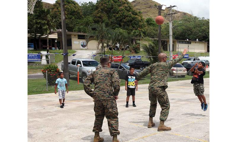 1st Lt. Dallas W. Beaty, right, plays basketball during Discovery Day festivities March 9 with children from Umatac, Guam. Beaty is an infantry officer with 3rd Battalion, 6th Marine Regiment, currently assigned to 4th Marine Regiment, 3rd Marine Division, III Marine Expeditionary Force, under the unit deployment program. Photo by Lance Cpl. Jeraco Jenkins