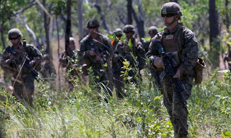 U.S. Marine infantrymen go on patrol during a live-fire exercise April 28, 2015 at Kangaroo Flats Training Area, Northern Territory, Australia. (Reba James/U.S. Marine Corps)