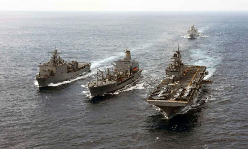 The amphibious dock landing ship USS Ashland, the amphibious transport dock ship USS Green Bay and the amphibious assault ship USS Bonhomme Richard participate in a replenishment-at-sea with the Military Sealift Command fleet replenishment oiler USNS Pecos in the East China Sea, March 11, 2015. (Cameron McCulloch/U.S. Navy)