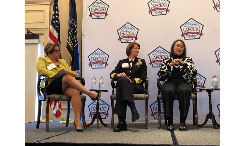 Janice Haith, left, former deputy chief information officer for the Navy Department, speaks with Navy Vice Adm. Nancy A. Norton, center, director of the Defense Information Systems Agency, and Bonnie M. Hammersley, right, the Defense Department's deputy chief information officer for resources and analysis, during a fireside chat as part of a Women in the Department of Defense Luncheon hosted by Armed Forces Communications and Electronics Association at the Army-Navy Country Club in Arlington, Virginia.