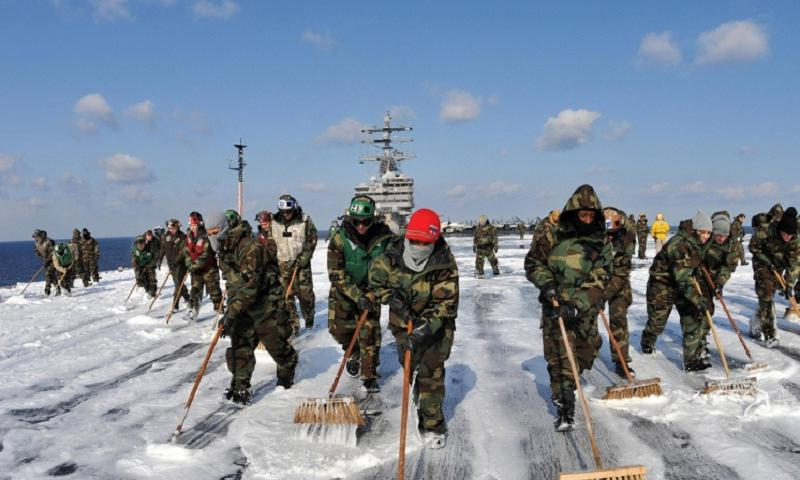 Sailors aboard the USS Ronald Reagan scrubbed the external surfaces of the flight deck and island superstructure to remove potential radiation contamination on March 23, 2011, while at sea off the coast of Japan, where the aircraft carrier was providing humanitarian assistance as directed in support of Operation Tomodachi. (Nicholas A. Groesch/U.S. Navy)