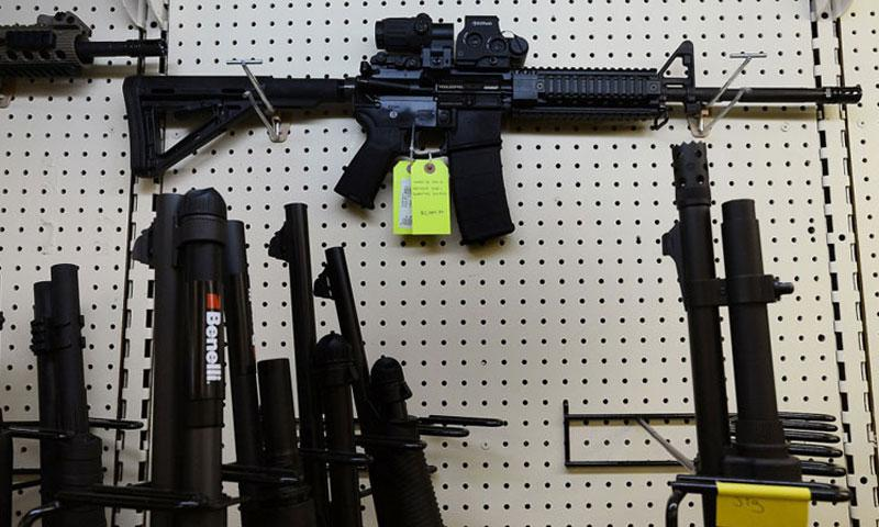 An AR-15 assault rifle featuring an EoTech optical sighting system and a 30-round magazine capacity is seen in a gun shop in North Carolina. (CHUCK LIDDY, RALEIGH NEWS & OBSERVER/MCT)