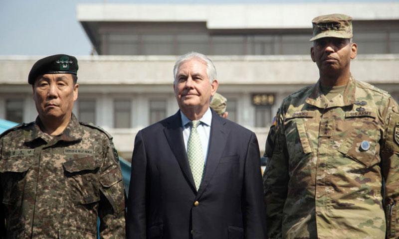 Secretary of State Rex Tillerson, center, poses with Gen. Vincent Brooks, right, U.S. Forces Korea commander, and South Korean Gen. Leem Ho Young at the Joint Security Area of the Demilitarized Zone, Friday, March 17, 2017.  (MARCUS FICHTL/STARS AND STRIPES)