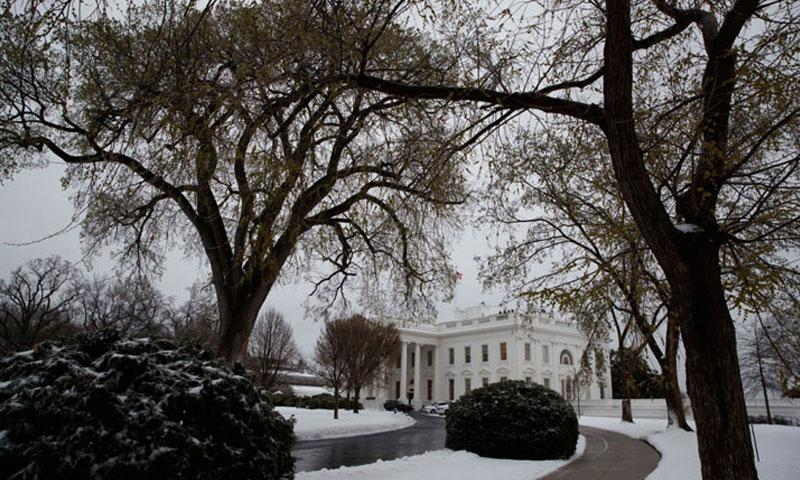 Snow covers the ground outside of the White House in Washington, Tuesday, March 14, 2017. (EVAN VUCCI/AP PHOTO)