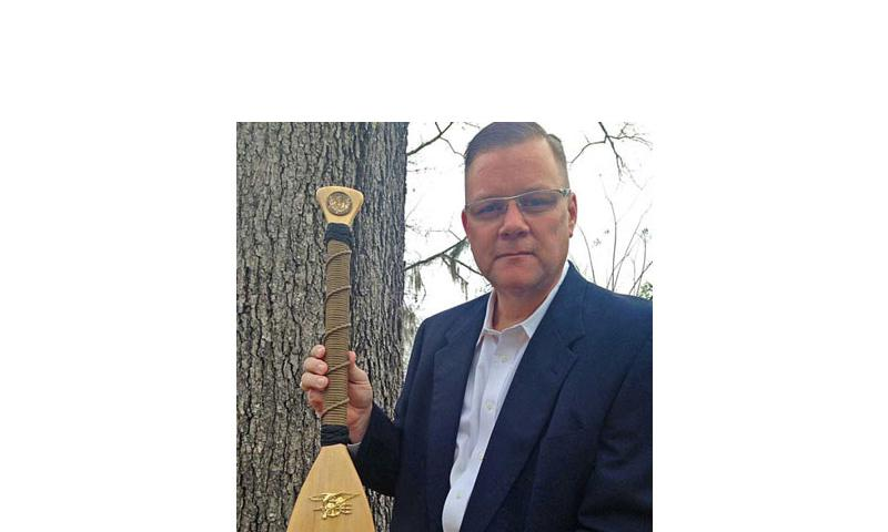 Chaplain Lt. Cmdr. Wesley Modder, shown here holding the ceremonial oar given to him by Naval Special Warfare Command. Modder may be forced out of the Navy for allegedly scolding sailors for homosexuality and premarital sex. (Photo courtesy of the Liberty Institute)