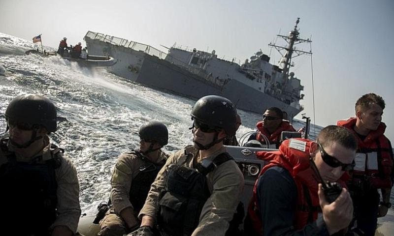 Sailors assigned to the guided-missile destroyer USS Bulkeley prepare to conduct a visit, board, search and seizure exercise in the Gulf of Oman. Bulkeley is deployed as part of the Harry S. Truman Carrier Strike Group in the U.S. 5th Fleet area of responsibility. (Donald R. White Jr./U.S. Navy)
