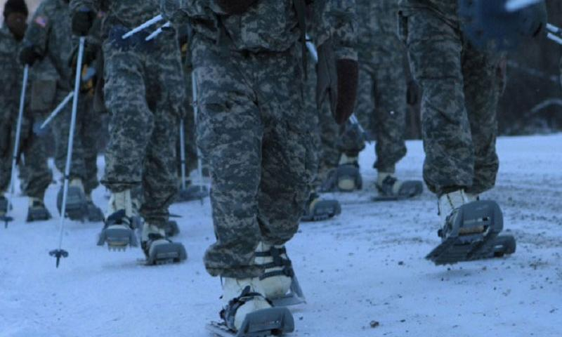 In this file photo from Nov. 2, 2012, soldiers march to the start line for a snow-shoe race at Fort Wainwright, Alaska.