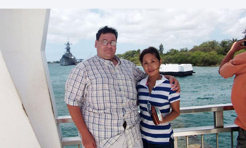 David and Li-Rong Radich pose at the USS Arizona Memorial in Honolulu. After his wife was brutally attacked in 2010, David Radich considered buying a handgun for self-defense, but laws currently prevent him from owning one on the U.S. Commonweath of Northern Mariana Islands. (Courtesy of David Radich)