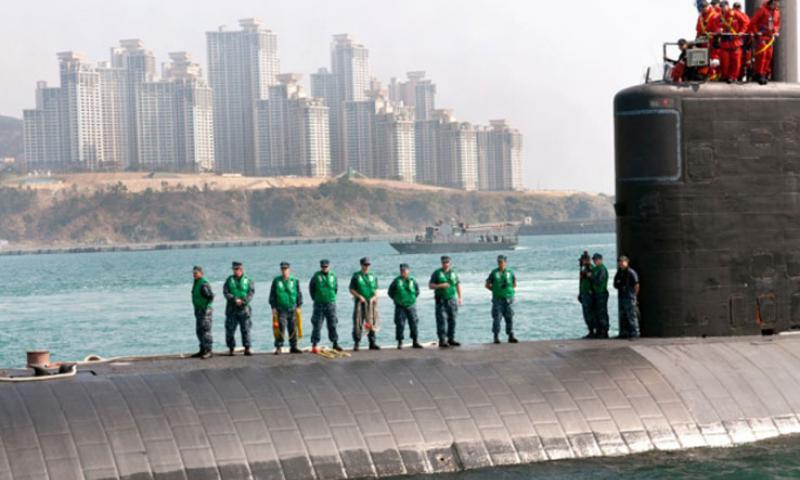 """Nuclear attack submarine USS Cheyenne is guided into into a Busan port by two South Korean Navy tugboats March 20, 2013. The Cheyenne participated in bilateral naval exercise Foal Eagle, much to the dismay of North Korea which issued a new round of threats Thursday saying U.S. military bases in Japan and Guam are within its """"striking range."""" (Joshua B. Bruns/U.S. Navy)"""