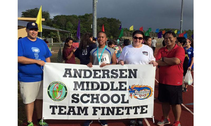 Left to right, Jason Sheedy, Principal AMS, Joshua Nededog, Student Athlete, Michelle Gros, Special Education Teacher AMS, Brian Palaganas, NJHS Sponsor at the, Parade of Athletes during the opening ceremony of the 40th annual Special Olympics Guam