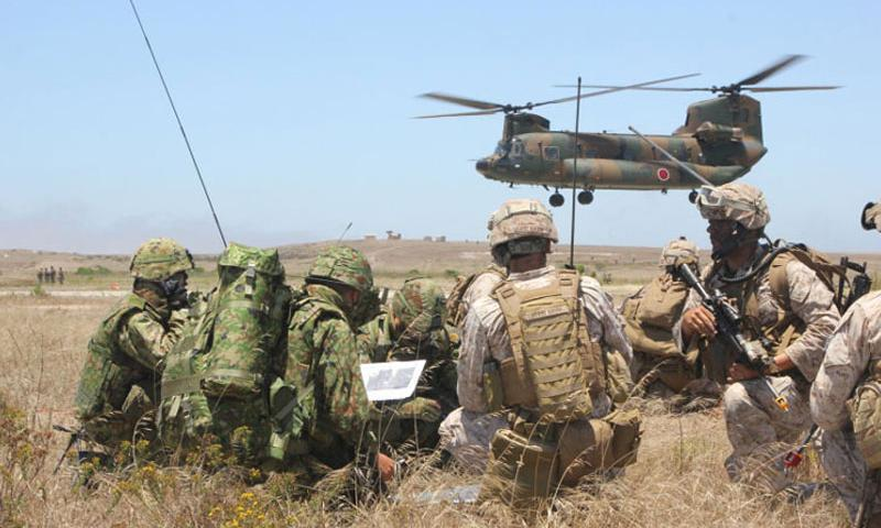 U.S. Marines and Japanese Self-Defense Force soldiers go over maneuver tactics while conducting amphibious assault operations on San Clemente Island, June 17, 2013. Laws that would allow Japanese forces to defend its close allies if under attack will take effect March 29, 2016. (Courtesy of the U.S. Marine Corps)