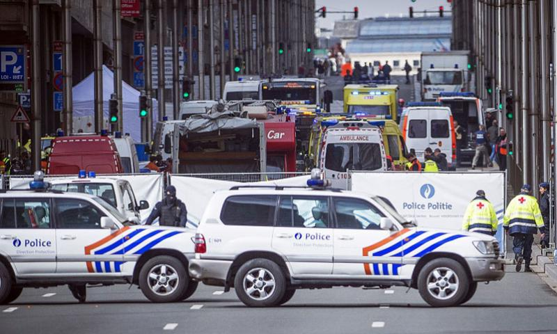 Wetstraat/Rue de la Loi is evacuated at the Maelbeek subway station in Brussels on Tuesday, March 22, 2016, after attacks claimed by the Islamic State killed dozens in the Belgian capital. A U.S. military family was among the scores of people wounded in the attacks, a European Command spokesperson said. (Laurie Dieffembacq/Belga/Zuma Press/TNS)