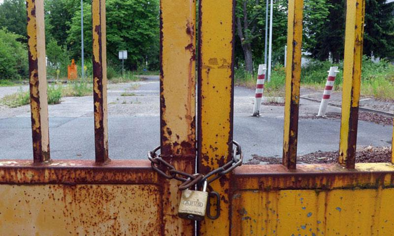 A locked gate bars entry to a former U.S. base in Darmstadt, Germany. As President Donald Trump pushes a plan to increase defense spending by 10 percent, some members of Congress say it's time to save money by closing military bases. (MICHAEL ABRAMS/STARS AND STRIPES)