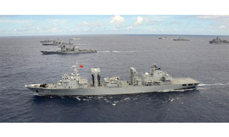 PLA Qiandaohu, a Chinese navy ship, steams in close formation as one of 42 ships and submarines representing 15 international partner nations during Rim of the Pacific 2014. Defense Secretary Ashton Carter said the Pentagon is constantly evaluating China's militarization of the South China Sea but stopped short Tuesday, March 22, 2016, of agreeing with a Hawaii congressman's proposal to revoke China's invitation to the prestigious global naval exercise. (Shannon Renfroe/U.S. Navy)
