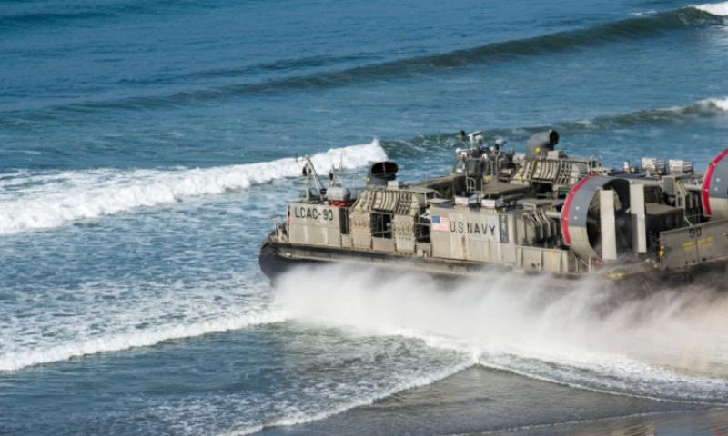 A Landing Craft Air Cushion 90 carries heavy vehicles and troops to a designated landing beach as part of Exercise Iron Fist on Feb. 19, 2014 in California. The Japanese military, which worked alongside the U.S. Marine Corps during the exercise, is trying to establish full-scale amphibious operational capability. (Eric Coffer/U.S. Navy)