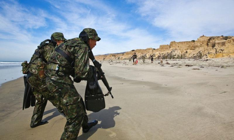 Japan Ground Self-Defense Force soldiers secure a beach while conducting an amphibious raid during Exercise Iron Fist 2014 aboard Camp Pendleton, Calif., Feb. 15, 2014. (Ricardo Hurtado/U.S. Marine Corps)