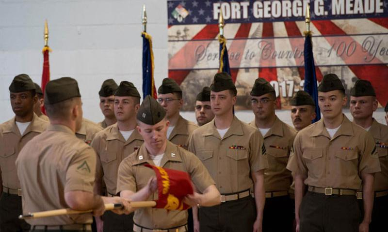 Marines with Marine Corps Cyberspace Warfare Group prepare to post the guidon during an activation of command ceremony at Fort George G. Meade, Md., March 25, 2016. Its mission is to man, train and equip Marine cyberspace mission teams to perform both defensive and offensive operations in support of U.S. Cyber Command and Marine Forces Cyberspace Command. (Courtesy of the U.S. Marine Corps)