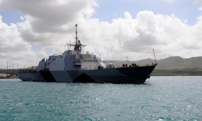 130329-N-TR604-001 SANTA RITA, Guam (March 29, 2013) The littoral combat ship USS Freedom (LCS 1) makes its way into Apra Harbor at U.S. Naval Base Guam. Freedom is on a deployment to the Indo-Asia-Pacific region conducting maritime security operations. (U.S. Navy photo by JoAnna Delfin/Released)