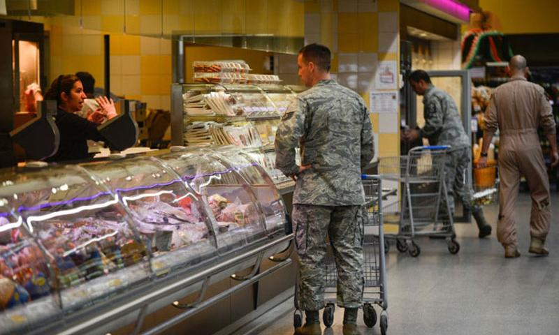 Customers shop at the commissary on Ramstein Air Base, Germany. A RAND study says raising prices in military commissaries to offset decreases in tax-payer dollars could be a bad idea. (Joshua L. DeMotts/Stars and Stripes)