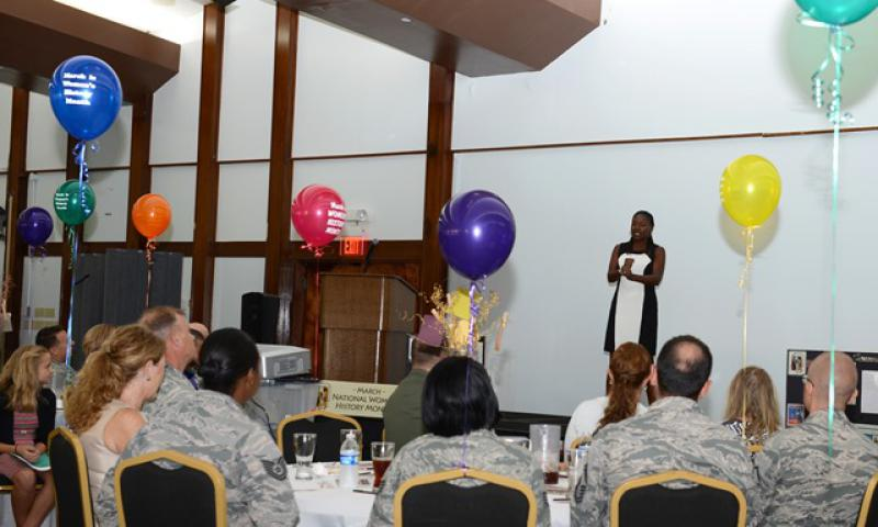 Tanya McMillan, an Air Force retiree and wife of 36th Wing Command Chief Master Sgt. Michael McMillan's wife, speaks during a Women's History Month luncheon March 31, 2015, at Andersen Air Force Base, Guam. This year's theme is 'Weaving the Stories of Women's Lives' and focused on sharing the experiences and obstacles women faced. (U.S. Air Force photo by Airman 1st Class Arielle Vasquez/Released)