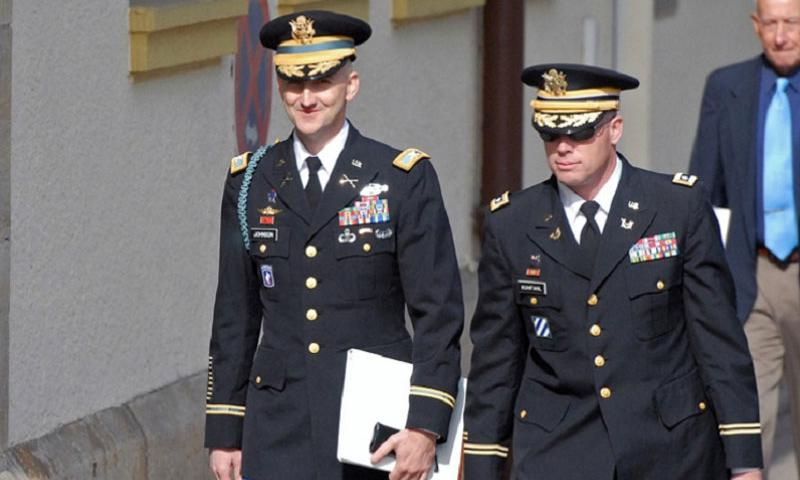 Col. James H. Johnson III, left, walks with his defense counsel Lt. Col. Charles Kuhfahl, to the courtroom at Kleber Kaserne in Kaiserslautern, Germany, for the opening day of his court-martial. Johnson pleaded guilty to 15 of 27 specifications, including bigamy, adultery and fraud. Behind them is Johnson's father, retired Lt. Gen. James H. Johnson Jr. (Michael Abrams/Stars and Stripes)