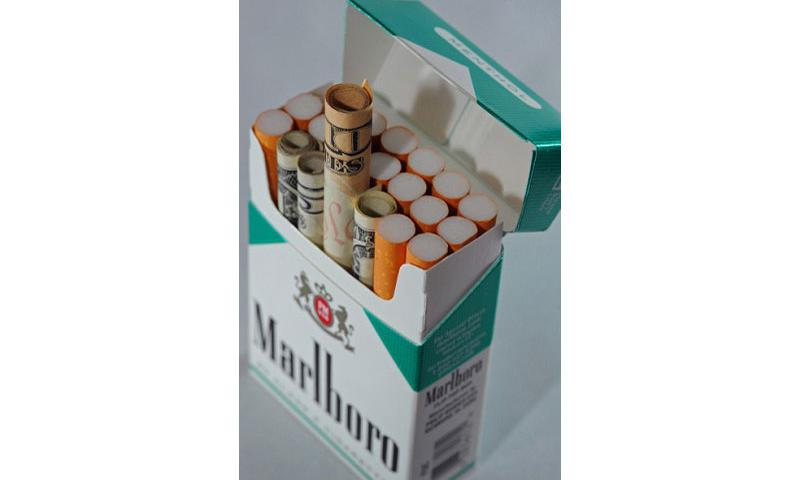 According to data available in April 2010, Americans spend each year more than $50 billion on cigarettes, essentially smoking their money away. Roughly 30% of military active duty personnel smoke, and the Department of Defense health care system spends roughly $930 million dollars on smoking-related illnesses. This photo won honorable mention as an illustrative in the 2011 Military Photographer of the Year competition. (Jodi Martinez/US Air Force/MCT)