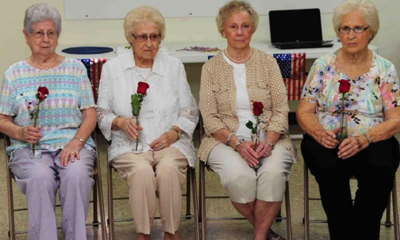 In an August, 2015 ceremony at Milan, Tenn., four surviving spouses of Korean War veterans received roses in memory of their late husbands and to recognize their personal sacrifices during the war. From left to right: Jean Cole (Ralph W. Cole), Jane Powers Montgomery (L.L. Powers), Mildred Hill (G. Edwin Hill), and Margie Hilliard Holt (David B. Hilliard).  William Jones/Tenn. National Guard