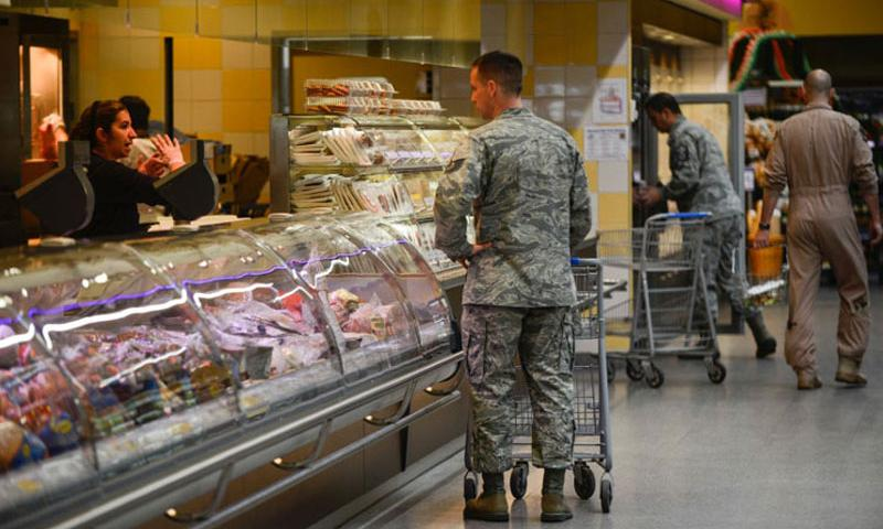 Customers shop at the commissary on Ramstein Air Base, Germany. (Joshua L. DeMotts/Stars and Stripes)