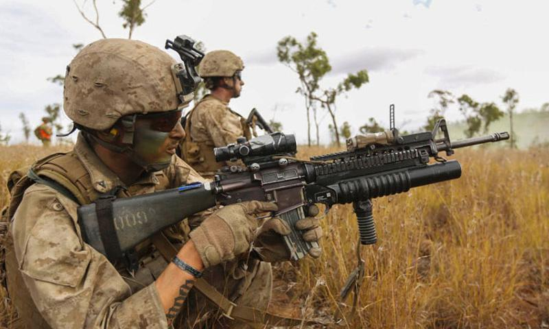 A Marine with Marine Rotational Force - Darwin fires an M203 40-mm grenade launcher during a training exercise last year in Queensland, Australia. About 1,250 Marines are heading to Australia for the fifth deployment of Marine Rotational Force-Darwin. The Marine Corps has been deploying annually to Darwin on six-month rotations since 2012. (Angel Serna/U.S. Marine Corps)