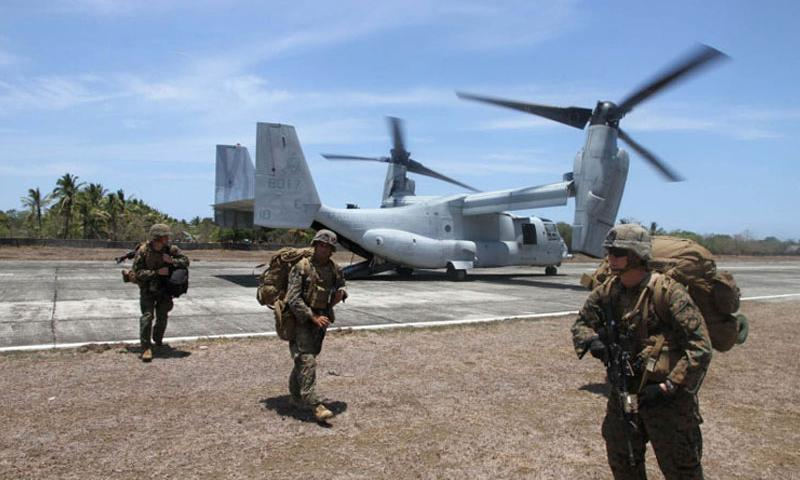 Marines disembark from an MV-22 Osprey after landing at an airstrip in Panay, Philippines, during Exercise Balikatan, Monday, April 11, 2016. The Marines were acting as a follow-up force for an earlier amphibious landing by Filipino marines. (Wyatt Olson/Stars and Stripes)