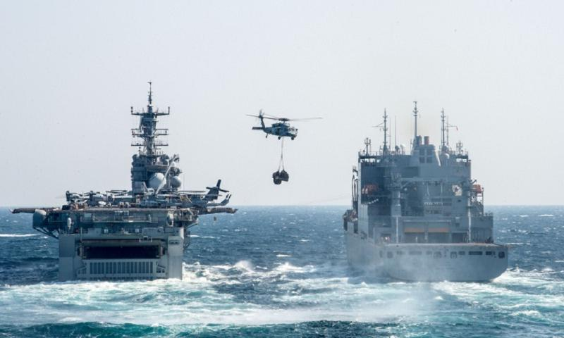 The amphibious assault ship USS Bonhomme Richard is replenished at sea during amphibious force operations somewhere in the East China Sea, April 14, 2014. (Bradley J. Gee/U.S. Navy)