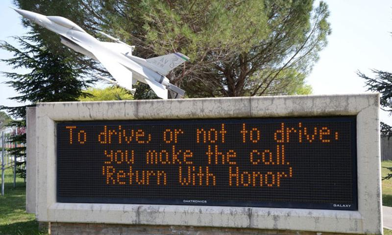An electronic sign displays a drinking-and-driving slogan near the flight line gate at Aviano Air Base, Italy. The 31st Fighter Wing commander conducted two sessions with airmen on April 22, 2015 to address a recent string of DUIs in the last 60 days. (Jason Duhr/Stars and Stripes)