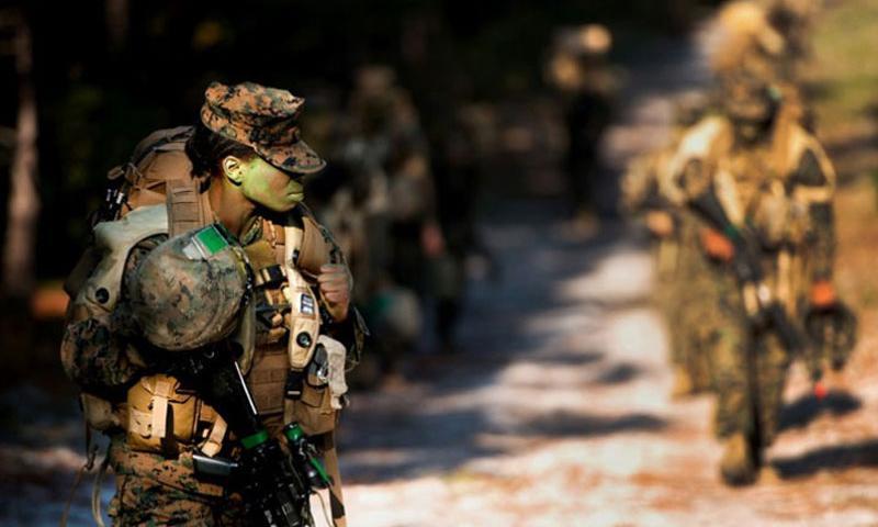 Female Marine infantry students hike during patrol week near Camp Geiger, N.C., in October 2013. (Tyler L. Main/U.S. Marine Corps)