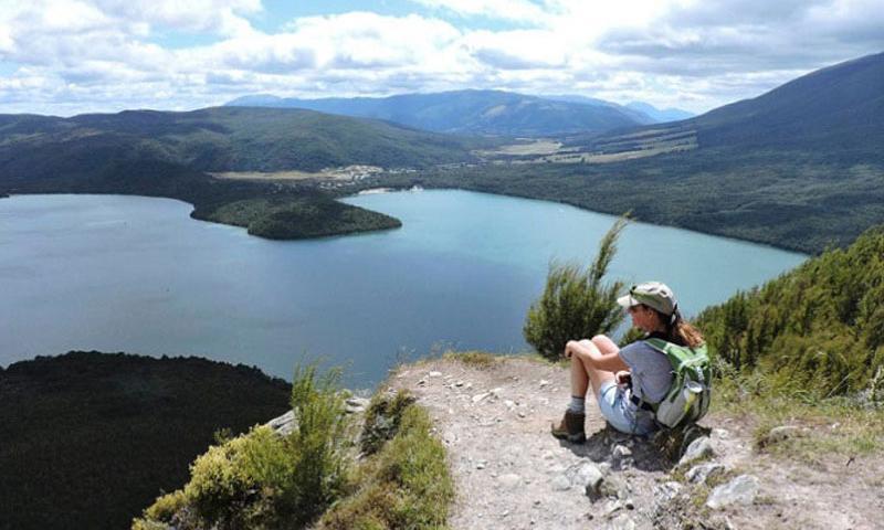 A trekker enjoys the view of Lake Rotoiti near the top of Mount Roberts in New Zealand. (Mark Muckenfuss/Orange County Register/TNS)