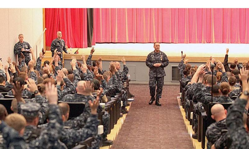 Master Chief Petty Officer of the Navy Michael D. Stevens speaks to sailors at an all-hands call at Yokosuka Naval Base, Japan, on April 23, 2014. Taking an informal poll, Stevens asked the sailors to raise their hands if they would rate Navy morale as ''good.'' (Trevor Andersen/Stars and Stripes)