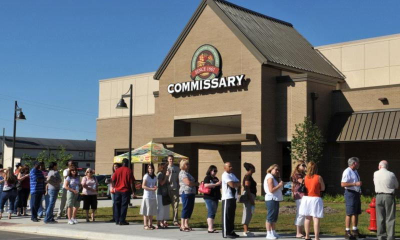 Customers wait in line for the grand opening of the new commissary at Fort Campbell, Ky. on June 13, 2012. (Photo by Sam Shore/U.S. Army)