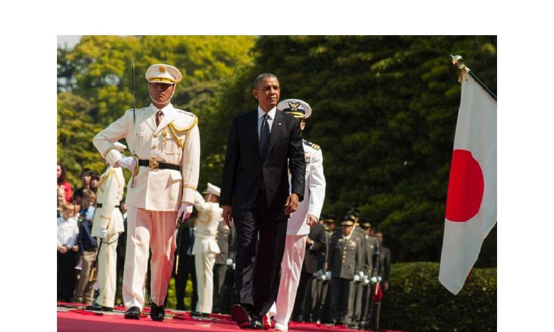 President Barack Obama reviews troops from the Japan Self-Defense Force and met with Emperor Akihito at the Imperial Palace in Tokyo, Japan, April 24, 2014. (Eric Guzman/Stars and Stripes)