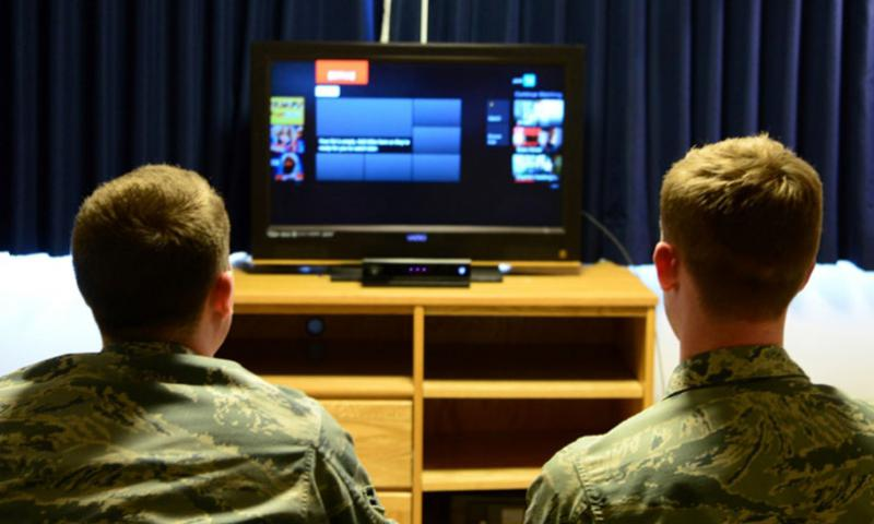 Airmen search through an online streaming service. (Patrick S. Ciccarone/US.. Air Force photo)
