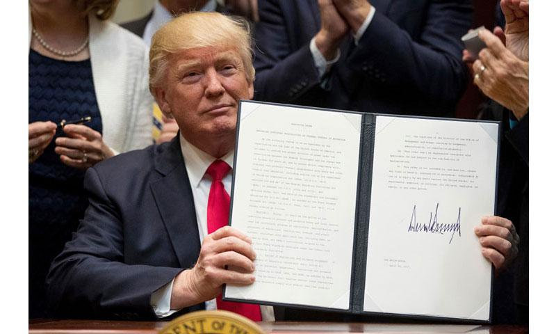 President Donald Trump holds the signed Education Federalism Executive Order during a federalism event with governors in the Roosevelt Room of the White House in Washington, Wednesday, April 26, 2017. (ANDREW HARNIK/AP)